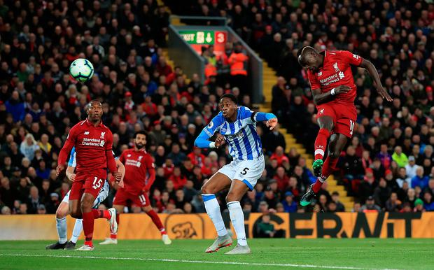 Sadio Mané soars into the air to head home Liverpool's second goal on their way to a 5-0 victory over Huddersfield Town last night. Photo: Peter Byrne/PA Wire