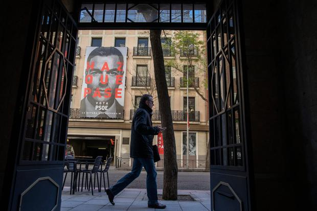 Up in the air: A banner of Spain's outgoing Prime Minister Pedro Sanchez looks down from his party's Madrid HQ. Photo: Pablo Blazquez Dominguez/Getty Images