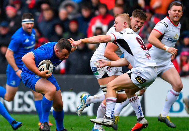 Bryan Byrne of Leinster is tackled by Dave Shanahan of Ulster