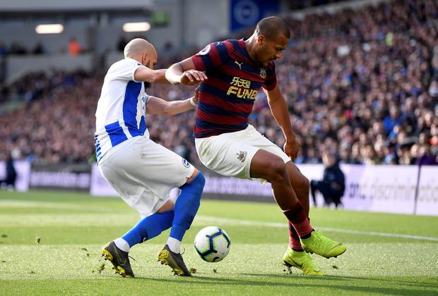 Newcastle United's Salomon Rondon in action with Brighton's Bruno Saltor. Photo: Toby Melville/Reuters