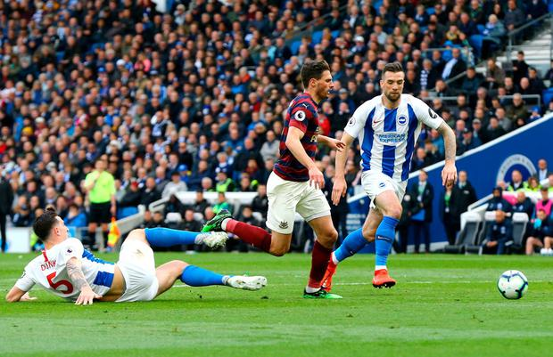 Newcastle United's Fabian Schar (centre) in action as Brighton & Hove Albion's Lewis Dunk (left) attempts a tackle. Photo: Gareth Fuller/PA Wire