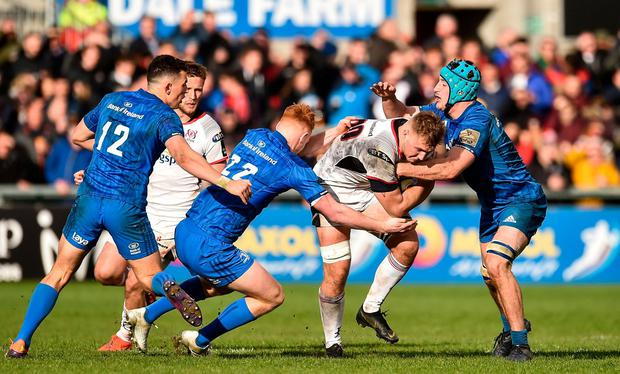 Johnny McPhillips of Ulster is tackled by Ciaran Frawley and Will Connors of Leinster. Photo: Oliver McVeigh/Sportsfile
