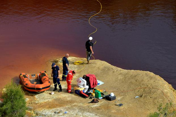 Forensics officers search Kokkinopezoula lake, also known as