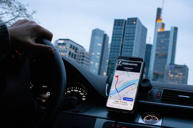 The Uber Technologies app on the screen of a driver's phone in Frankfurt, Germany. Photo: Alex Kraus/Bloomberg