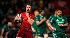 JJ Hanrahan of Munster celebrates after scoring his side's third try