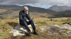 FRUSTRATION: Cllr Dan McCarthy tries to operate his iPad in the Black Valley, Killarney. The area under Carrauntoohil and the Gap of Dunloe was the last place in Ireland to be electrified and could be the last place to get broadband. Photo: Don MacMonagle