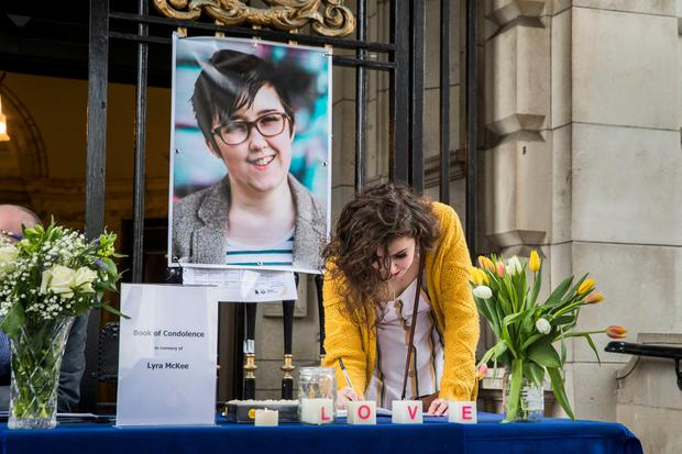 NEW GENERATION: Signing a book of condolence at Belfast City Hall in memory of murdered Lyra McKee. Photo: Liam McBurney/PA Wire