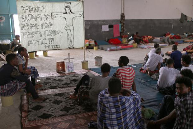 CAUGHT IN THE MIDDLE: Migrants sheltering in the Anti-Illegal Immigration Agency in Tajora shelter centre in Tripoli, Libya. Picture: REUTERS/Ahmed Jadallah