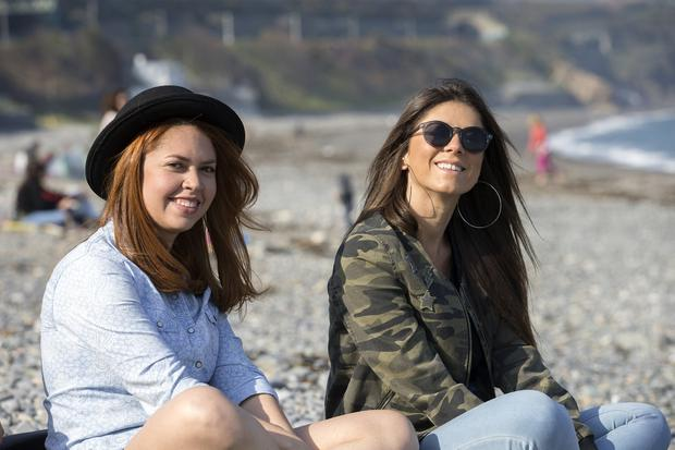 Josy Fygoeredo and Marina Baz on the beach at Killiney. Warm weather is expected to return for the weekend Photo: Tony Gavin