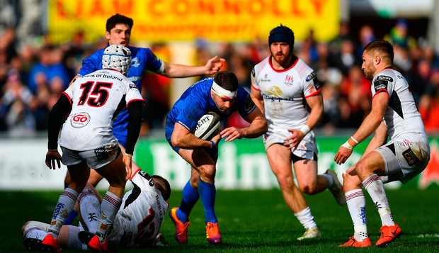 Fergus McFadden of Leinster in action against Michael Lowry, left, and Johnny McPhillips of Ulster