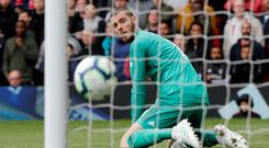 Manchester United v Chelsea - April 28, 2019 Chelsea's Marcos Alonso scores their equalising goal as Manchester United's David de Gea looks on Photo Credit: REUTERS/Phil Noble