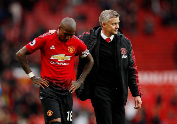 Manchester United's Ashley Young looks dejected with manager Ole Gunnar Solskjaer after his side's draw with Chelsea. Picture credit: Action Images via Reuters/Jason Cairnduff