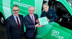Greener: An Post ceo David McRedmond, Climate Minister Richard Bruton and Postwoman Gemma Lalor. Photo: Maxwells