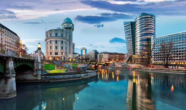 Different model: The Danube Canal in Vienna where 60pc of homes are social housing, owned by co-operatives. Stock Image