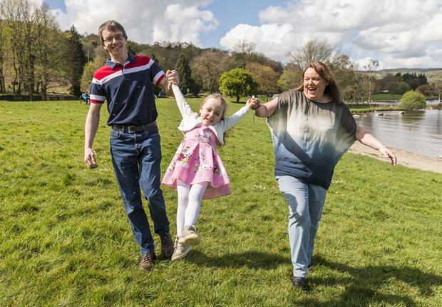 Appeal: Mary Benson McMahon (3) with her parents Thereze and Michael. Photo: Eugene McCafferty