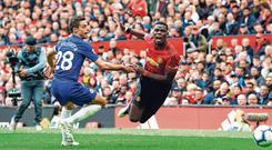 In full flight: Paul Pogba of Manchester United goes to ground after a challenge from Chelsea's Cesar Azpilicueta. Photo: Jason Cairnduff/Action Images via Reuters