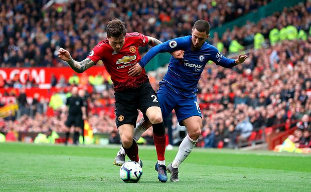Manchester United's Victor Lindelof (left) and Chelsea's Eden Hazard battle for the ball. Photo: Martin Rickett/PA Wire