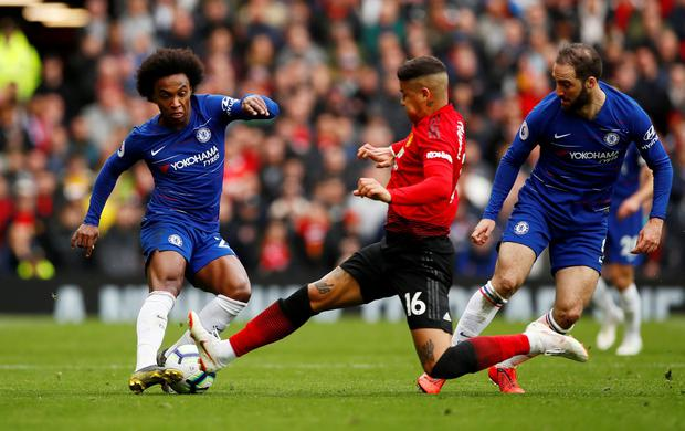 Manchester United's Marcos Rojo fouls Chelsea's Willian. Photo: Jason Cairnduff/Action Images via Reuters