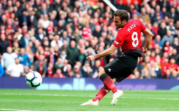Manchester United's Juan Mata scores his side's goal. Photo: Martin Rickett/PA Wire