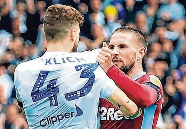 Leeds United's Mateusz Klich is confronted by Aston Villa's Conor Hourihane. Photo: Clint Hughes/PA Wire