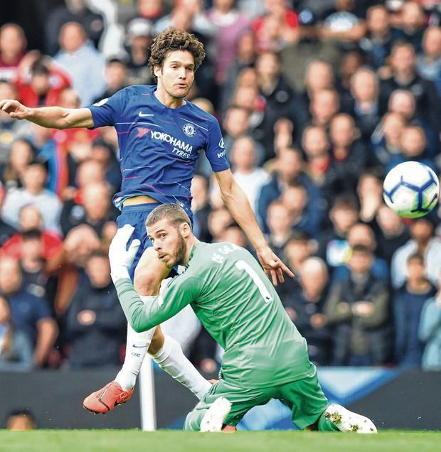 Marcos Alonso fires home Chelsea's equalising goal past David de Gea after a blunder by the Manchester United goalkeeper at Old Trafford. Photo: Darren Walsh/Chelsea FC via Getty Images