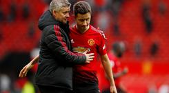 Manchester United manager Ole Gunnar Solskjaer with Ander Herrera after the match