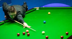 Kyren Wilson in action against Scott Donaldson during day six of the 2019 Betfred World Championship at The Crucible, Sheffield. Danny Lawson/PA Wire