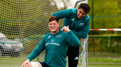 Jack O'Donoghue shares a joke as Joey Carbery adjusts his GPA device during Munster's training session yesterday. Photo: Diarmuid Greene/Sportsfile