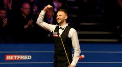 Judd Trump celebrates beating Ding Junhui during day ten of the 2019 Betfred World Championship at The Crucible, Sheffield. Simon Cooper/PA Wire