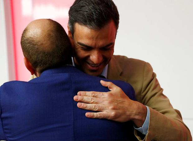 Spain's acting Prime Minister Pedro Sanchez is congratulated before a party meeting a day after Spain's general election. Photo: Juan Medina/Reuters
