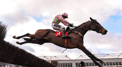 Min, with Ruby Walsh up, jumps the last on their way to winning the John Durkan Memorial Punchestown Steeplechase last year