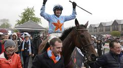 Jockey, Paul Townsend, celebrates after Un De Sceaux had won the Boylessports Champion Steeplechase at the first day of the Punchestown festival, Kildare. Picture credit; Damien Eagers / INM