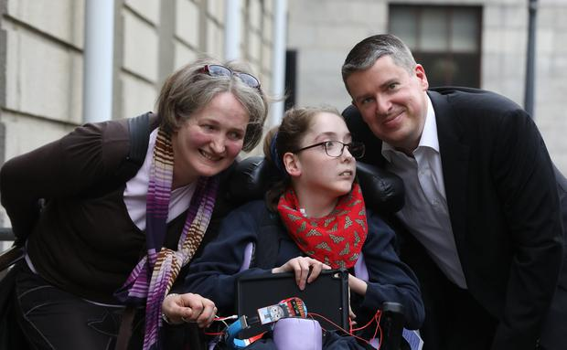 'One in a million': Orlaith Sweetman-Healy, from Inchicore, Dublin, with her parents, Cathie and Jim, outside the Four Courts. Photo: collins