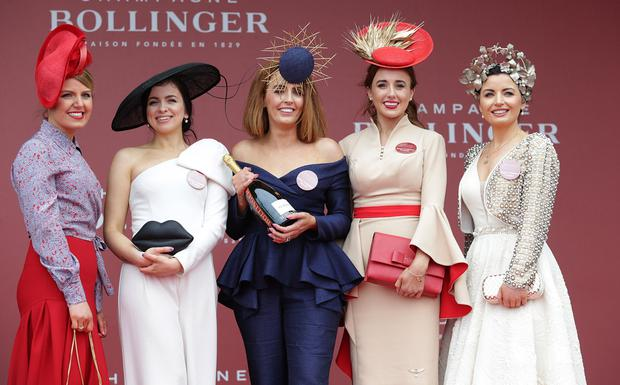Top hats: Best dressed lady finalists Maria Byrne, Vivienne O'Connor, winner Gretta Peters, Joanne Byrne and Sarah Cass, at the first day of the Punchestown festival, Kildare. Right, Paula McCormick from Thurles. Photo: Damien Eagers/Sportsfile