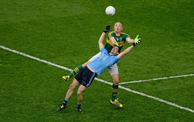 BATTLE FOR THE AGES: Dublin's Rory O'Carroll, battles in the rain against Kerry's Kieran Donaghy during the 2015 All-Ireland SFC final in Croke Park. Photo: Dáire Brennan/SPORTSFILE