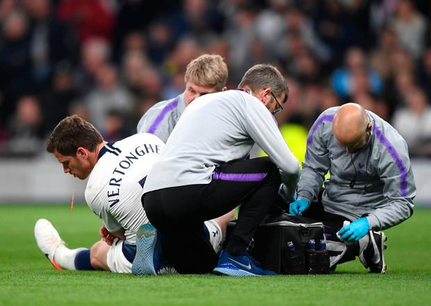 Jan Vertonghen of Tottenham Hotspur is given treatment before he was substituted after suffering a blow to the head during last night's Champions League semi-final first leg that was won by Ajax 1-0. Photo: Shaun Botterill/Getty Images