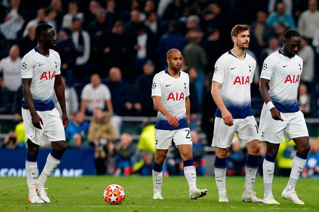 Tottenham players Davinson Sanchez (L), Lucas Moura (2nd L), Fernando Llorente (2nd R) and Moussa Sissoko (R) stagger off the pitch at the final whistle. Photo: AFP/Getty Images