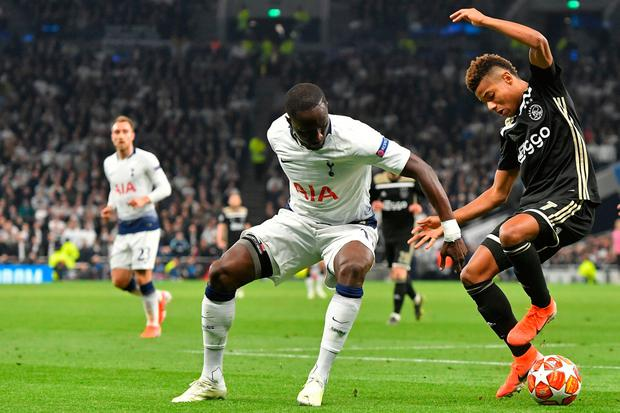 Moussa Sissoko battles for possession with Ajax's David Neres. Photo: AFP/Getty Images