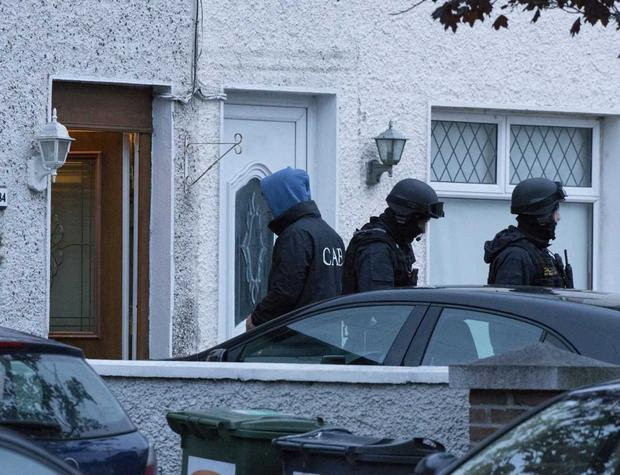 GardaI and CAB officers during a raid on a house today