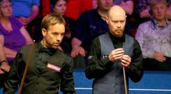 Ali Carter (left) and Gary Wilson during day twelve of the 2019 Betfred World Championship at The Crucible, Sheffield. Richard Sellers/PA Wire