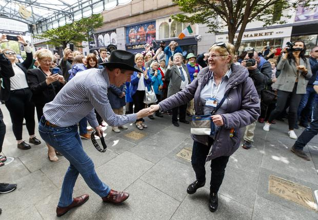 01/05/2019 Ryan Tubridy pictured with Marian Jennings as he performed with country star Cliona Hagan outside the Gaiety Theatre ahead of the RTÉ Late Late country Special this Friday. Picture Andres Poveda