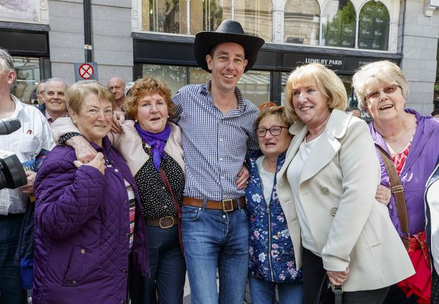 01/05/2019 Ryan Tubridy performed with country star Cliona Hagan pictured with members of the public outside the Gaiety Theatre ahead of the RTÉ Late Late country Special this Friday. Picture Andres Poveda