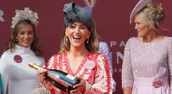 Kate Nally McCormack reacts after being announced as the winner of the Bollinger best dressed lady competition pictured at the second day of the Punchestown festival, Kildare. Picture credit: Damien Eagers / INM