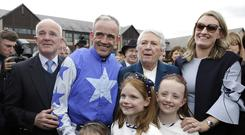 Jockey, Ruby Walsh with his wife Gillian, his daughters, Elsa, 8, Isabelle, 9 and Gemma, 5, and parents Ted and Helen after he announced his retirement from racing after winning the Coral Punchestown Gold Cup on Kemboy at the second day of the Punchestown festival, Kildare. Picture credit; Damien Eagers / INM