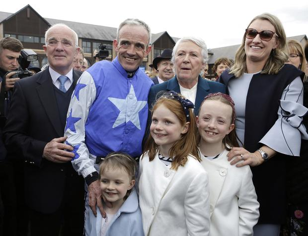 Cheltenham Racing Jockey, Ruby Walsh with his wife Gillian, his daughters, Elsa, 8, Isabelle, 9 and Gemma, 5, and parents Ted and Helen after he announced his retirement from racing after winning the Coral Punchestown Gold Cup on Kemboy at the second day of the Punchestown festival, Kildare. Picture credit; Damien Eagers / INM