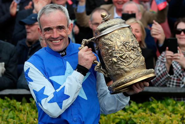 Ruby Walsh celebrates winning the Coral Punchestown Gold Cup on Kemboy, where he then announced his retirement, during day two of the Punchestown Festival at Punchestown Racecourse, County Kildare, Ireland. Brian Lawless/PA Wire