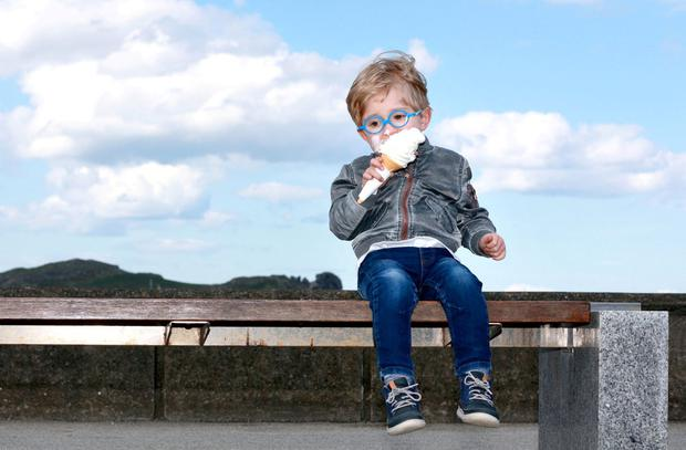 Time-out for a treat: Cian Somers (3) from Malahide, Co Dublin, tucks into an ice cream cone at Howth pier. Photo: Frank McGrath