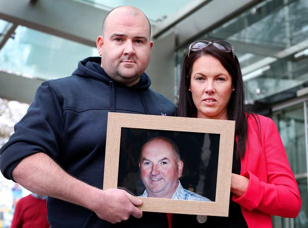 Memories: Bobby Ryan's children Robert and Michelle Ryan hold a photo of their father outside court after the verdict and sentence. Photo: Steve Humphreys