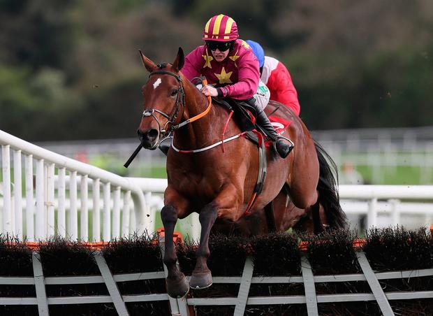 Minella Indo, ridden by Rachael Blackmore, clears the last on the way to winning the Novice Hurdle during day two of the Punchestown Festival yesterday. Photo: Brian Lawless/PA Wire