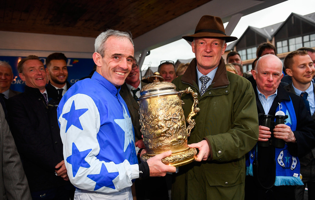 Golden handshake: Ruby Walsh and trainer Willie Mullins celebrate with the Gold Cup after Kemboy's success at Punchestown